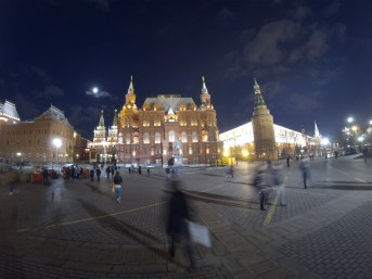 Kremlin at night, with a full moon overhead.
