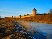 Sunset in Suzdal, looking across the river to one of the old walled complexes in the village.