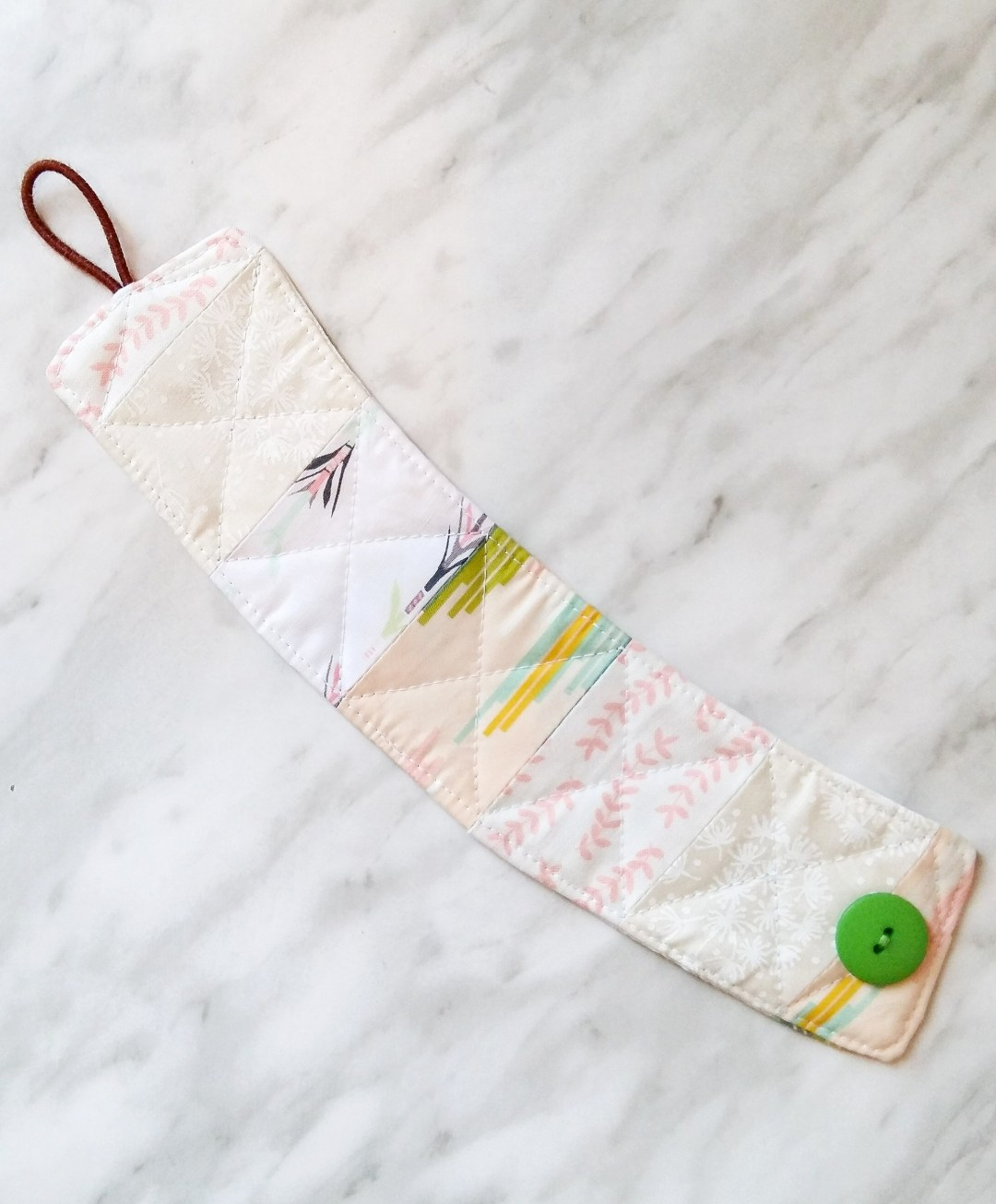 Quilted Fabric Coffee Cozy - Pretty and Functional! This quick DIY would be a great gift for mom!