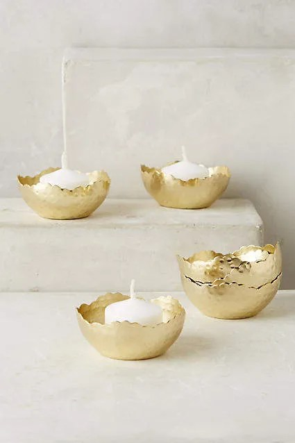 Super cute hammered gold tea light holders from Anthropologie. Perfect for adding a little Hygge ambiance to your home!