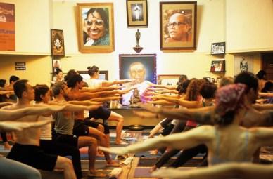 Studnets practice Ashtanga Yoga in Mysore, India.