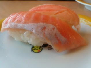 Two pieces of salmon sushi.