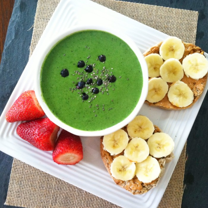 green smoothie bowl and fruit and english muffin