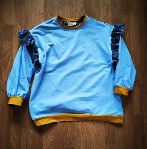 Flat lay of Wow jumper