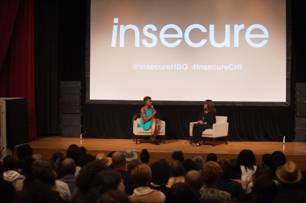 Issa Rae discussing Insecure with Chaz Ebert at show's premiere in Chicago. Credit: Fab Photo, Dan Merlo