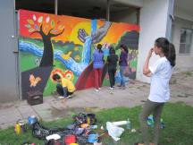 Youth artist Maryam Hassan contemplates the design of her tree (left)