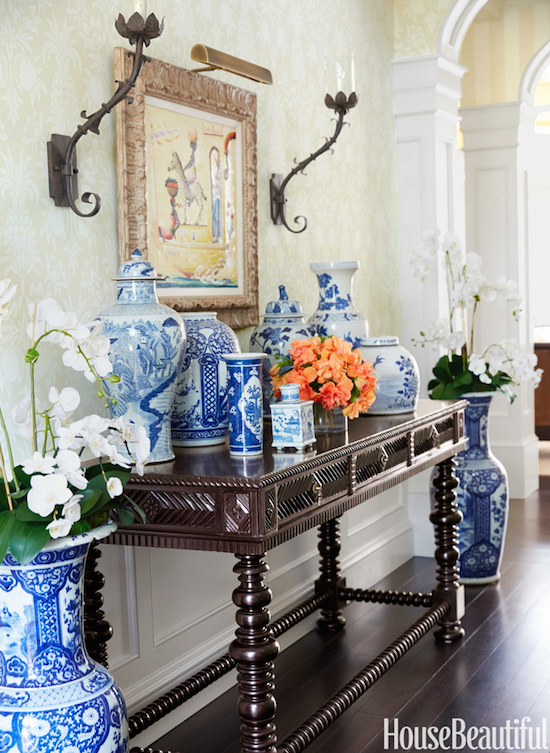 Palm Beach Decor in an entry foyer with blue and white jars
