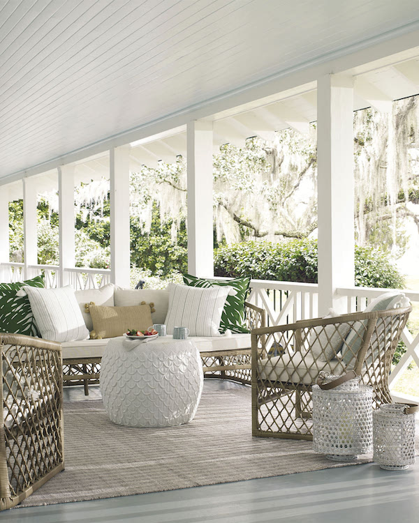 cane hurricanes on a porch in a m;odern white beach home