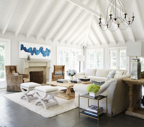beach house living room with exposed white beams
