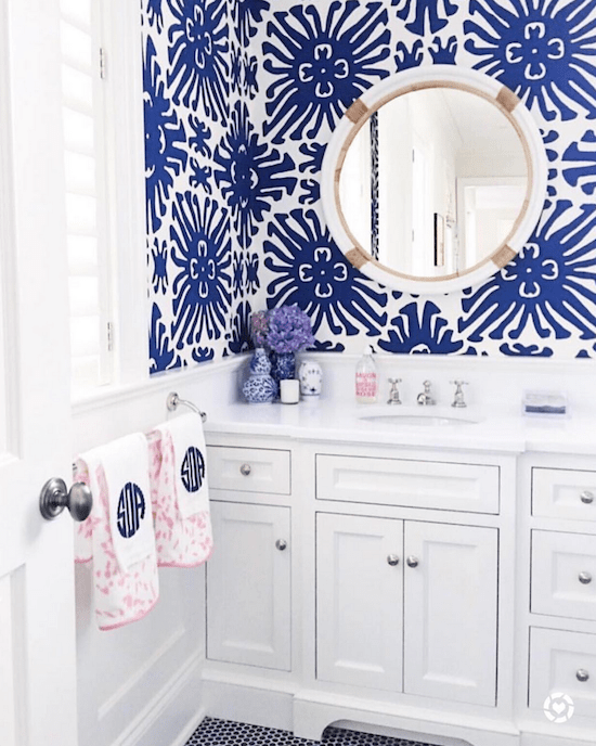 blue and white wallpapered powder room
