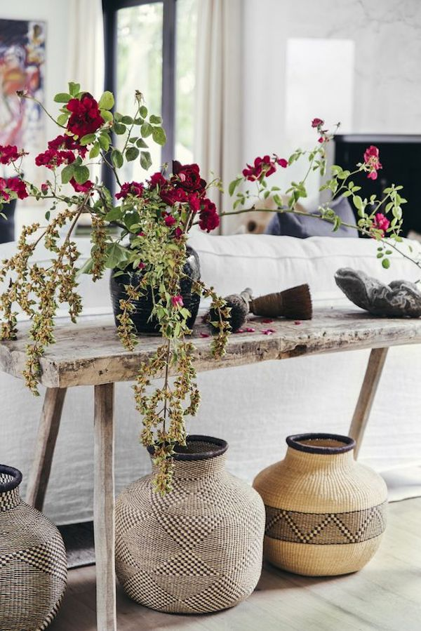 styled rustic console with plants and baskets