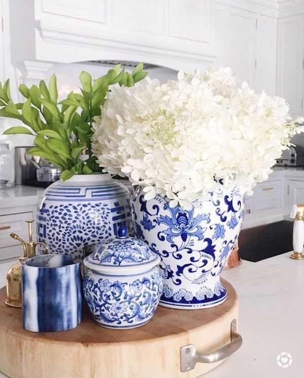 white kitchen with blue affordable home accessories
