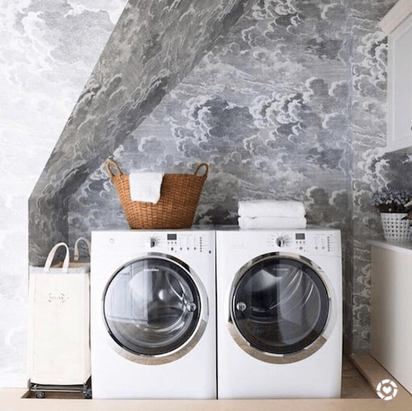 cloud wallpaper in laundry room