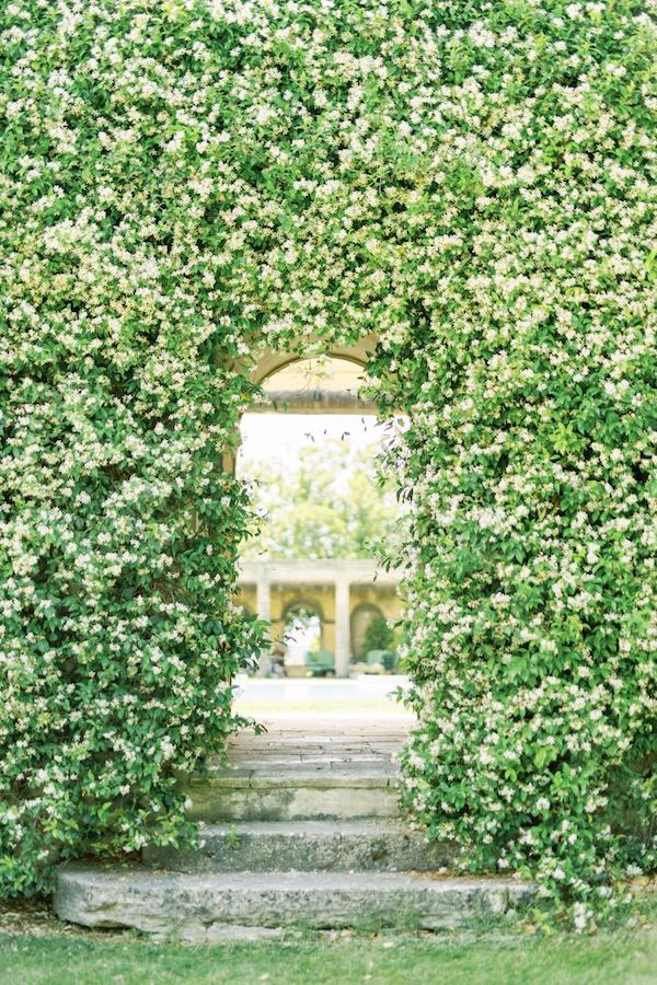 flowering hedge with arch cut in