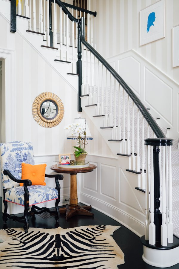 The best white paint colors for trim and baseboards - front foyer with white trim and baseboards