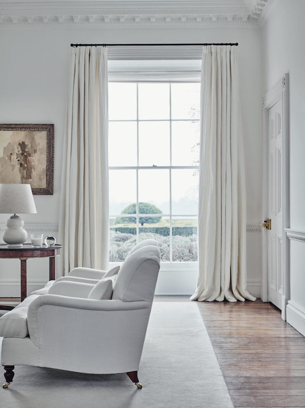 white and cream drapes in traditional living room