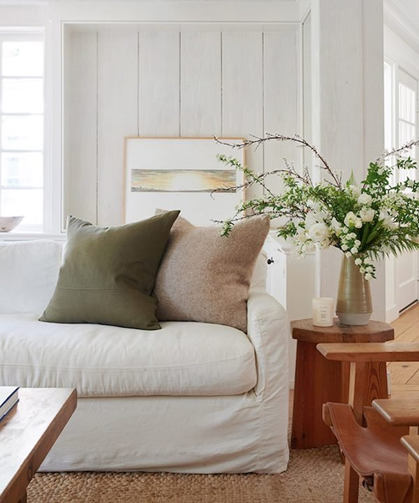 Linen pillows in neutral shades on a white couch.