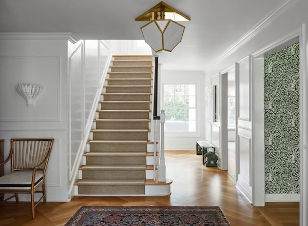 front foyer and stairs in a renovated traditional colonial