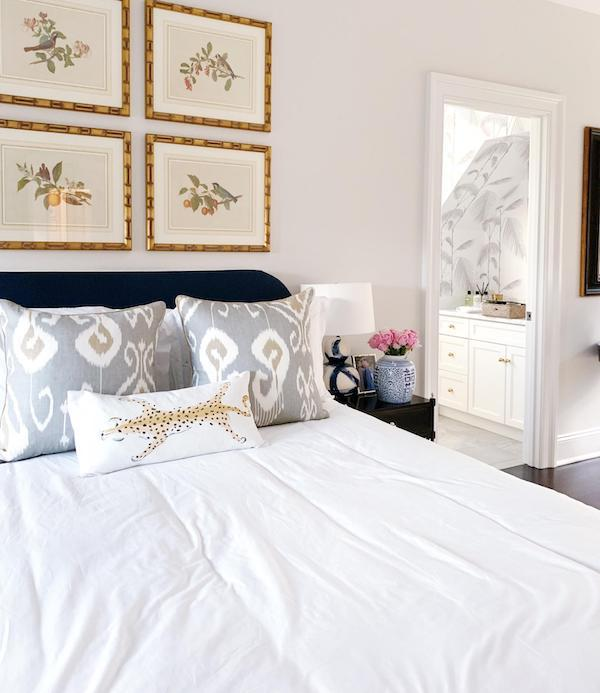 art and made white bed with pillows in guest room with Chantilly Lace by Benjamin Moore
