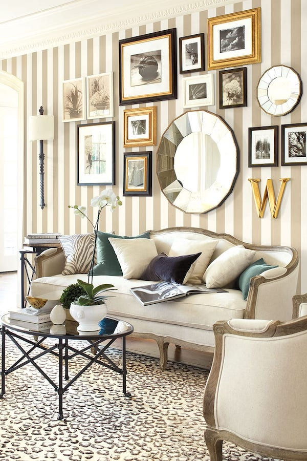 beautiful gallery wall on blank wall behind sofa
