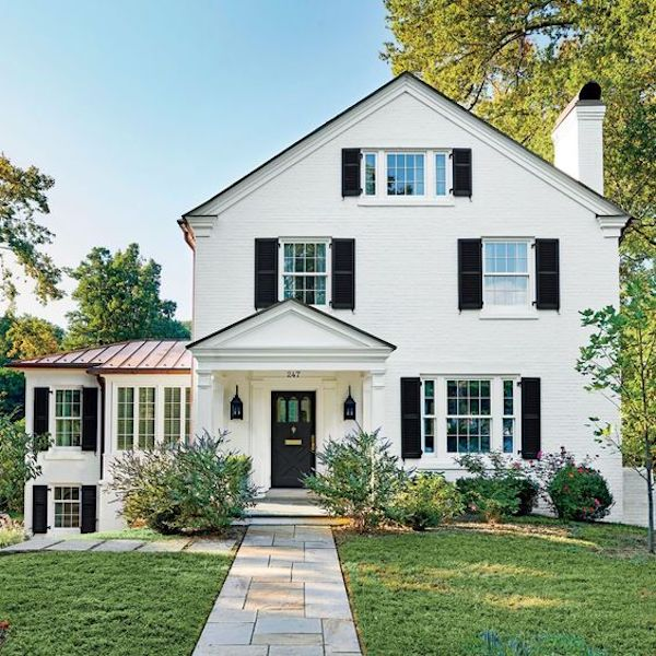 White Brick House in Sherwin Williams Creamy paint exterior color