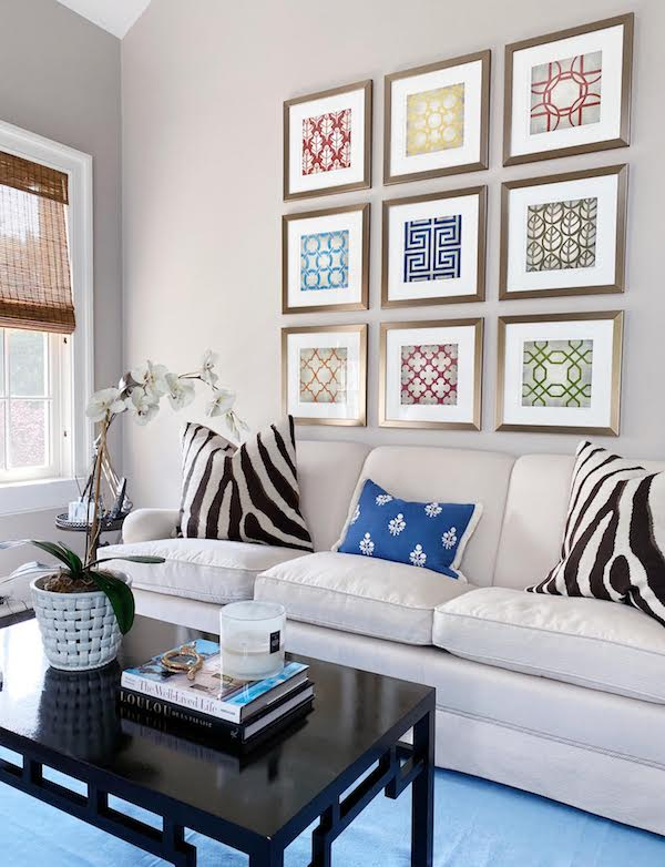 how to perfectly style the blank wall behind your sofa example with grid art hung above sofa
