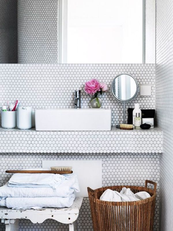 white penny tiles used all over in bathroom