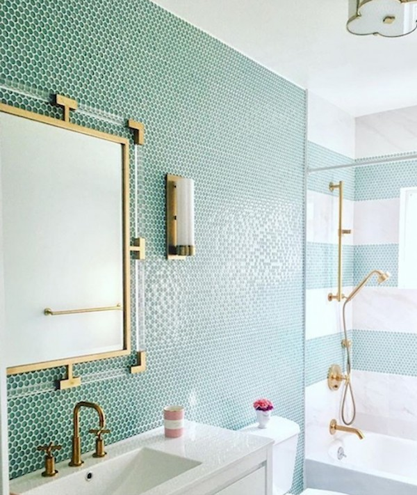 sea foam green penny tile wall in bathroom