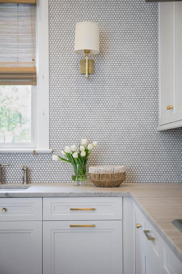 kitchen backsplash with white penny tiles
