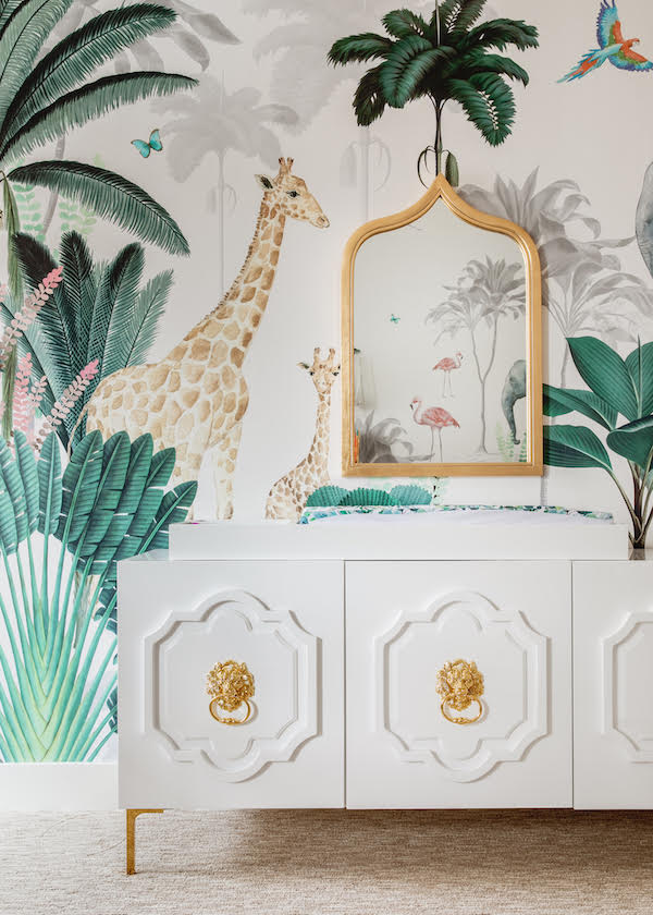 safari themed mural paper with gold mirror and white changing table