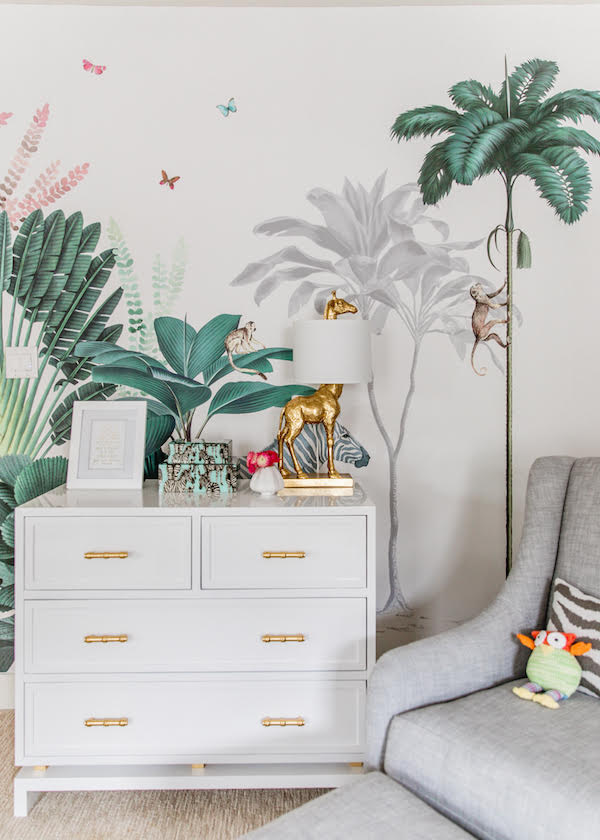 mural wallpaper with deep greens and palm trees in children's bedroom