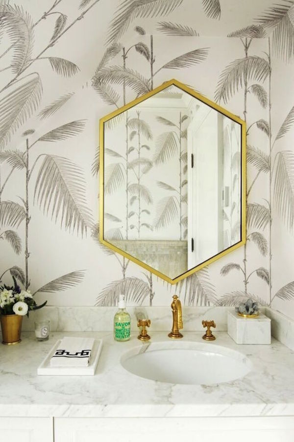 wallpapered bathroom with white marble counter