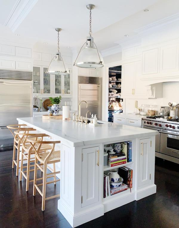 modern white kitchen with marble counters