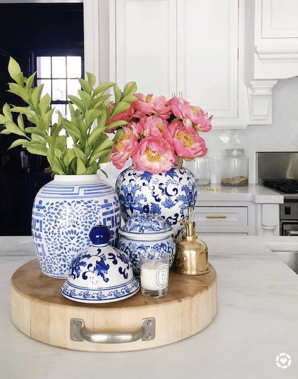 flowers in blue and white vases on white marble kitchen counter