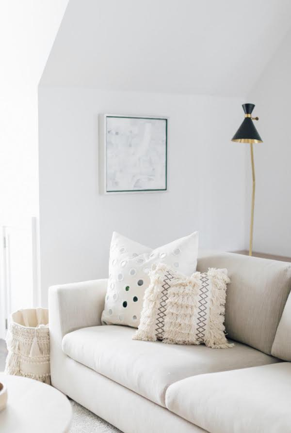 textured throw pillows styled on a neutral couch