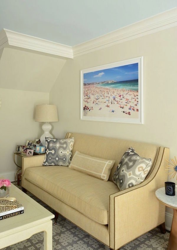 blue ceiling with Benjamin Moore Edgecomb Gray on walls and beach art over small sofa