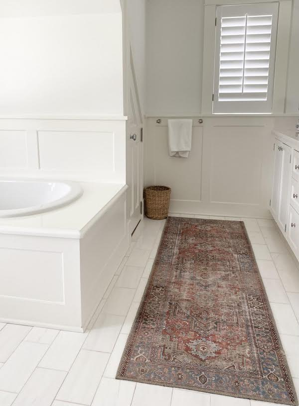 Persian Turkish style runner rug in all white bathroom