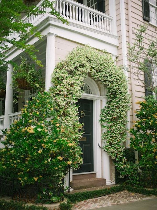 front entry of home in bloom in the spring