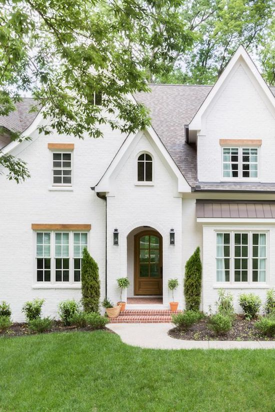 traditional home with white painted brick
