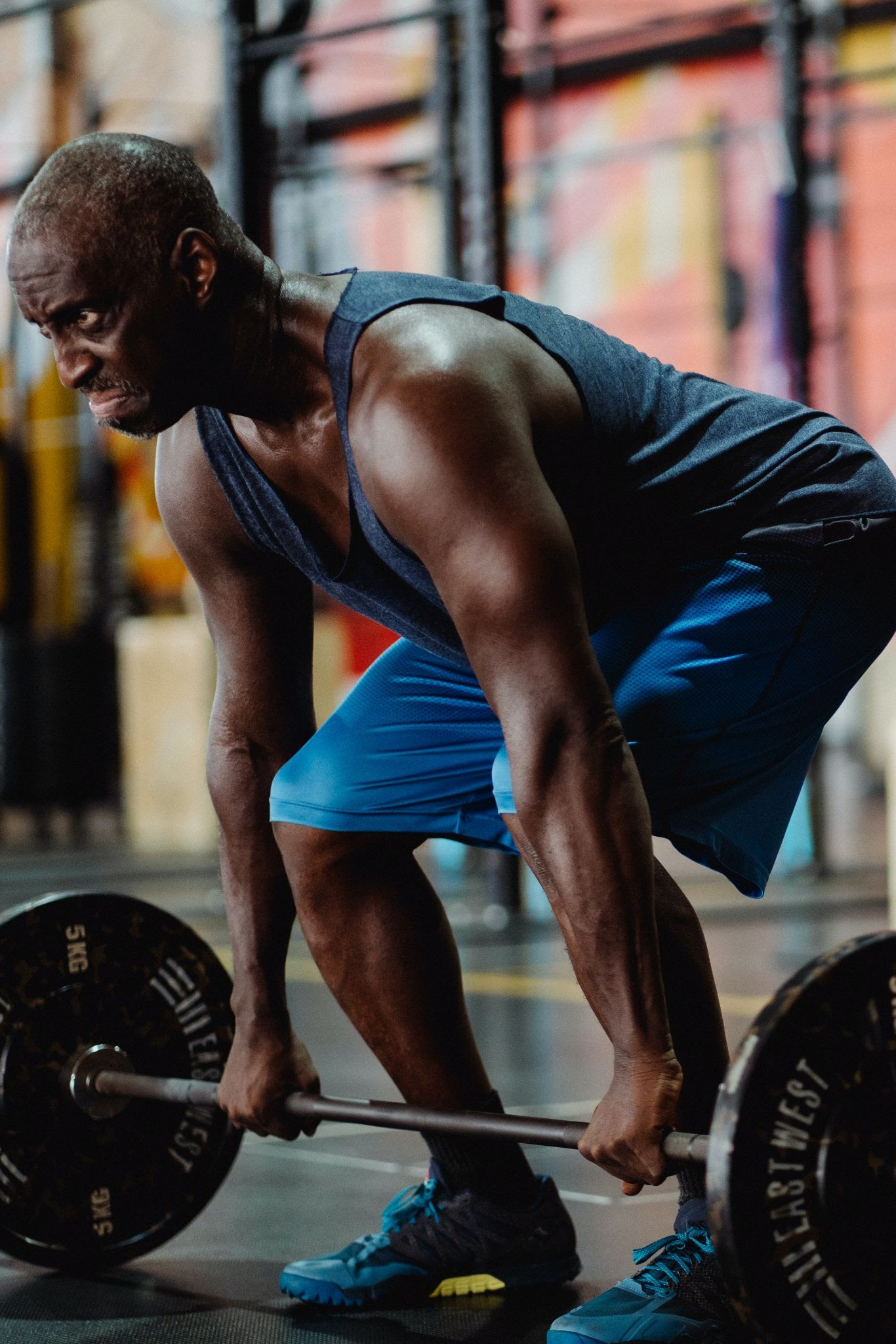 athlete deadlifting a heavy weight