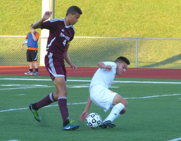 Naugatuck's Felipe Dutra and Watertown's CJ Martere fight to control the ball Wednesday during the scoreless draw between the 'Hounds and Indians. (Palladino/RA)