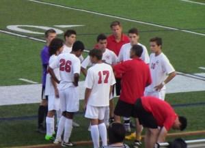 Cheshire team surrounds assistant coach Durval Pereira