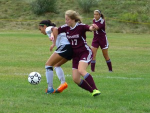 Woodland's Alexa Casimiro and Naugatuck's Hannah Lauer scrap for a loose ball Saturday during the 2-1 victory by the Hawks in Beacon Falls. Joe Palladino R-A
