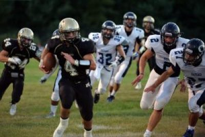 Woodland's Sean McAllen runs for one of his four touchdowns Friday night against Oxford in Beacon Falls. (Stan Strusky photo)