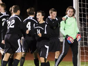 Pomperaug's Chris McFarland gets congratulations from his teammates after he successfully guarded the goal in a penalty kick in Watertown Monday night. Erin Covey Republican-American