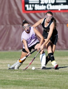 Pomperaug's Allison McCormick, left and Joel Barlow's Elisa Taylor-Yeremeva battle for the ball during their field hockey matchup in Southbury on Wednesday . Christopher Massa Republican-American