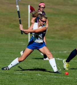 Lewis Mills' Julia Arel (4) fires a shot up field during their field hockey game against Shepaug  Tuesday at Lewis Mills High School in Burlington.   Jim Shannon Republican-American