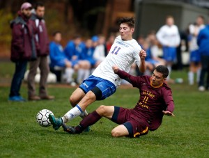Nonnewaug's Nathan Firlings, left, and Granby's Bryan McTeague collide while going for the ball during their state tournament matchup in Woodbury on Thursday.  Nonnewaug would go onto win, 2-1.      Christopher Massa Republican-American