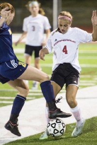 Pomperaug's Siobhan Lounsbury keeps possession of the ball with pressure from Weston's Nicole Werner Thursday night in Southbury. Erin Covey Republican-American.