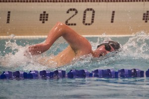 Cheshire's John Gaudio wins the 500 Freestyle event against Holy Cross at Kennedy High School Monday night. Erin Covey Republican-American